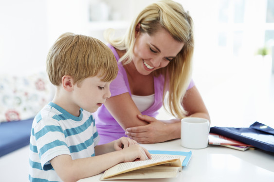 tutor helping child with homework