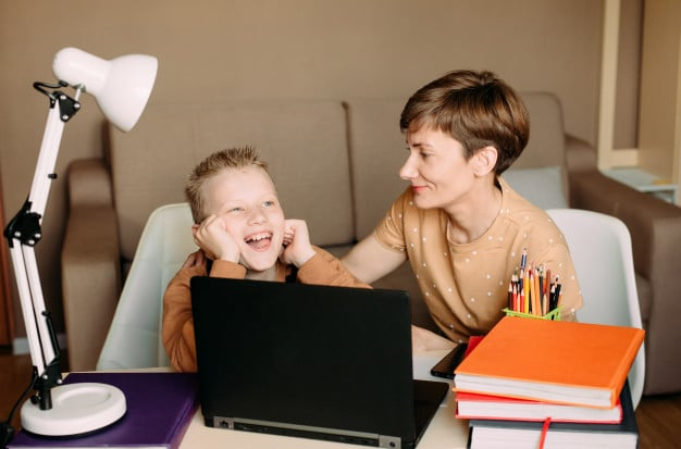 how to help your child with homework without actually doing it for them - tip no 9 praise your child for settling down and getting on with homework | Tutor2you